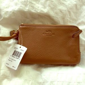 Coach leather wristlet.  Brand new with tags!